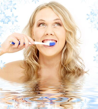 picture of happy blond with toothbrush in water Stock Photo - 3641468