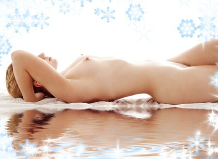classical picture of healthy naked woman on white sand Stock Photo