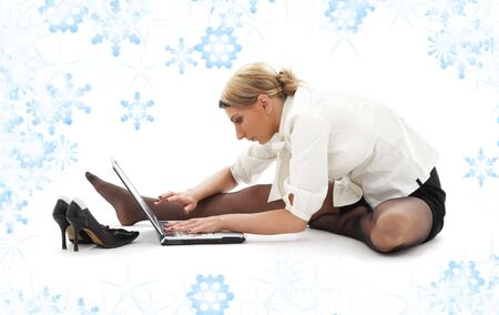 flexible businesswoman with laptop computer and snowflakes Stock Photo - 3641401