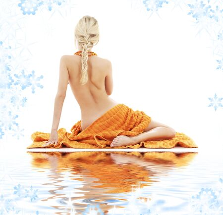 aqua naked: picture of beautiful lady with orange towels on white sand LANG_EVOIMAGES