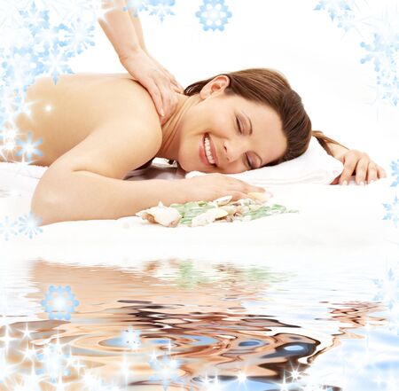 picture of lovely lady taking massage on white sand Stock Photo - 3641391