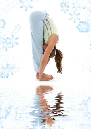 sporty girl practicing uttanasana standing forward bend on white sand Stock Photo - 3641331