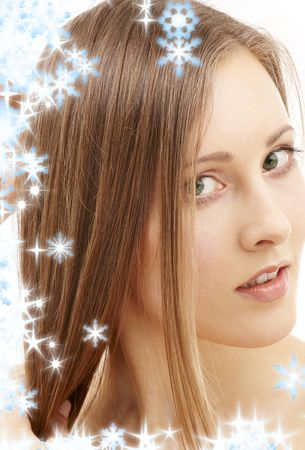 rejuvenating: picture of beautiful woman with long hair and snowflakes
