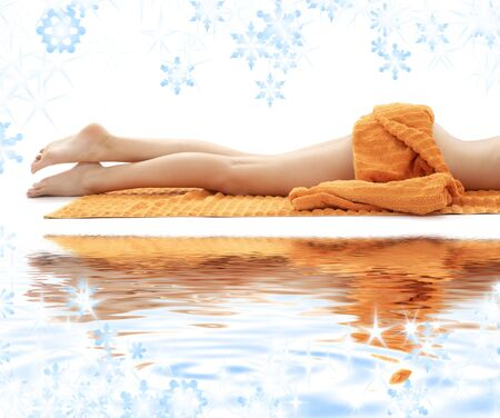 long legs of relaxed lady with orange towel on white sand Stock Photo - 3641325