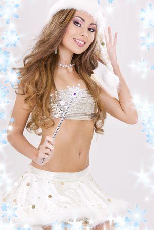 party dancer girl with magic wand in santa helper costume