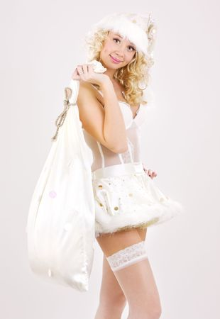 picture of cheerful santa helper girl with big bag Stock Photo - 3641582