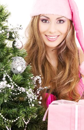 lovely santa helper girl with gift box and christmas tree Stock Photo - 3641697