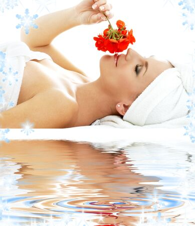 lovely woman in spa smelling red flower Stock Photo - 3660774