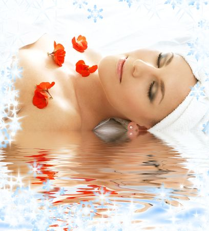 beautiful lady with red flowers in spa Stock Photo - 3701646