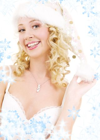 picture of cheerful santa helper girl with snowflakes Stock Photo - 3701673
