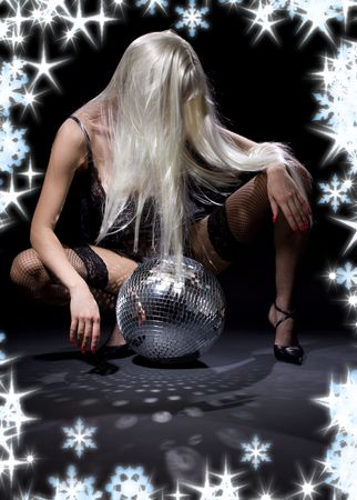 party dancer girl in fishnet stockings with disco ball Stock Photo - 3717512