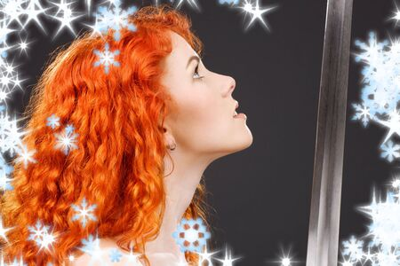 lovely redhead with medieval sword over grey Stock Photo - 3717541