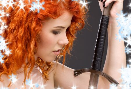 lovely redhead with medieval sword over grey Stock Photo - 3717539