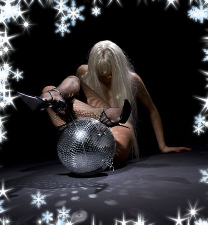 party dancer girl in fishnet stockings with disco ball (focus on ball) Imagens