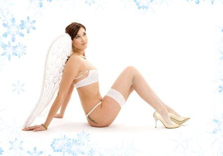 picture of brunette angel girl in white lingerie Stock Photo - 3796784