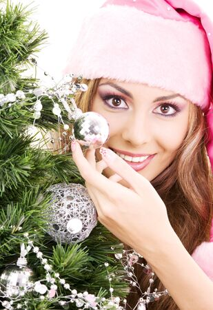 decorating christmas tree: lovely santa helper girl decorating christmas tree
