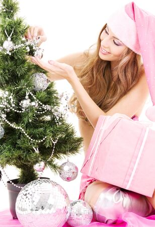 lovely santa helper girl with gift box decorating christmas tree Stock Photo - 3797159