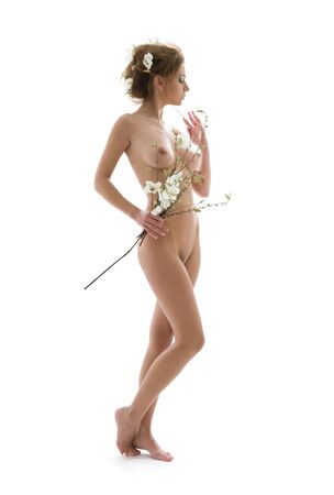 picture of naked woman with white flowers Stock Photo