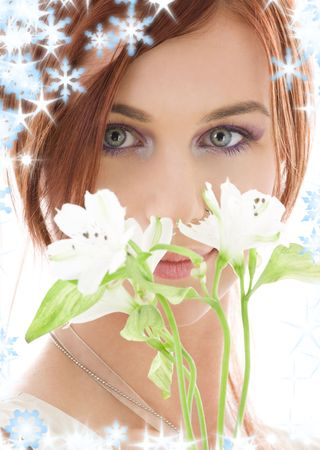 snow flowers: picture of lovely redhead with flowers and snowflakes LANG_EVOIMAGES