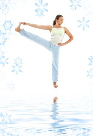 lovely girl practicing ashtanga yoga on white sand photo