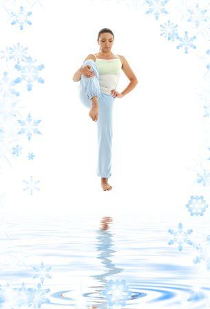 poise: lovely girl practicing ashtanga yoga on white sand
