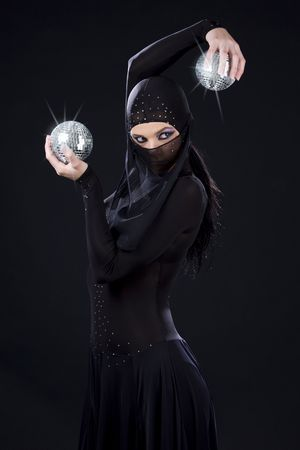 party dancer in ninja dress with disco balls Stock Photo - 3830127