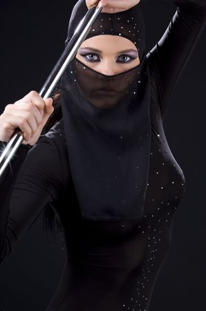 picture of ninja woman with shining pole Stock Photo - 3830125