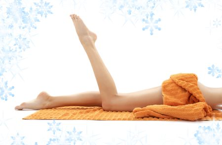 long legs of relaxed lady with orange towel Stock Photo - 3860423