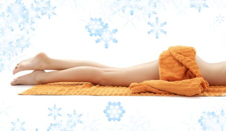 long legs of relaxed lady with orange towel Stock Photo - 3860422