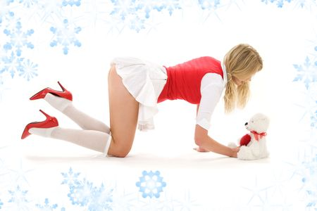 pin-up picture of sexy blonde playing with teddy bear