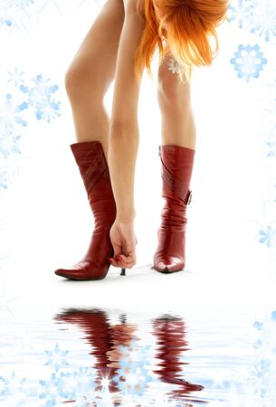 bodyscape: picture of redhead lady hooking her boot up