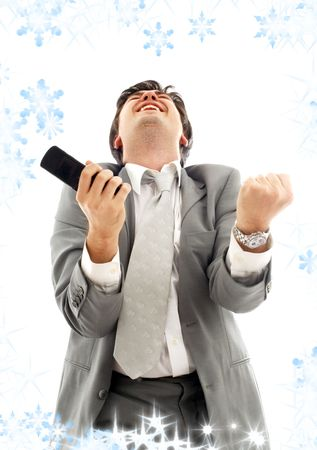 bandwagon: happy businessman with cellular phone and snowflakes LANG_EVOIMAGES