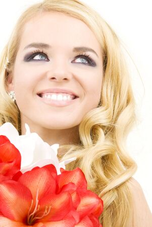 happy woman with red and white lily flowers Stock Photo - 3906318