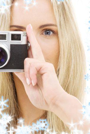 rangefinder: picture of lovely girl with old rangefinder camera