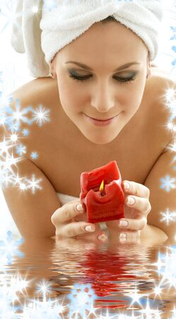 lovely woman with red candle in water Stock Photo - 3930162