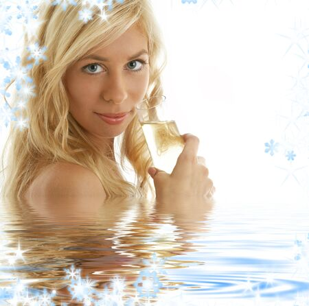 pretty blonde with glass of champagne in water photo