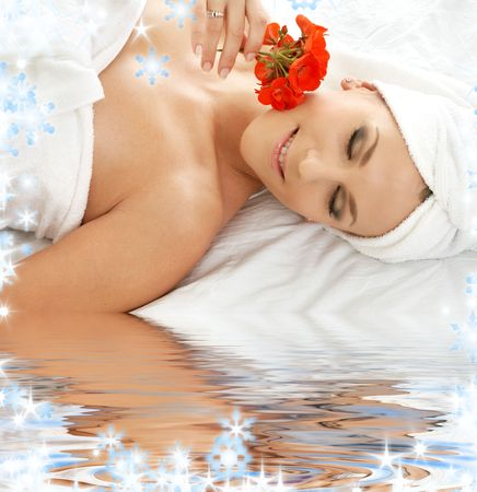 lovely woman in spa smelling red flower Stock Photo - 3944967