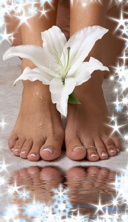 beautiful female feet with madonna lily in spa Stock Photo - 3944962