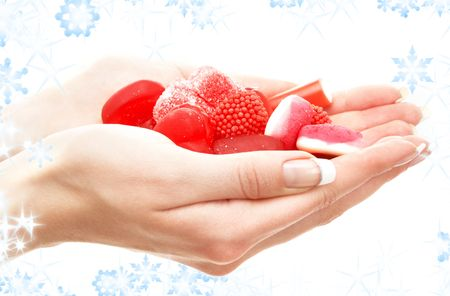 hands full of red bonbons with snowflakes Stock Photo - 3944982