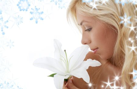 pretty lady with madonna lily and snowflakes photo