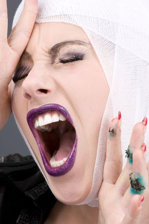picture of screaming wounded woman face over grey Stock Photo - 3967772