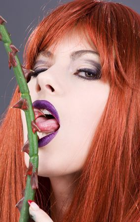 closeup portrait of redhead woman licking sharp torns Stock Photo - 4006845
