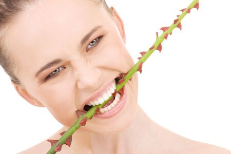 closeup portrait of beautiful woman biting sharp torns Stock Photo - 4033014