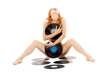 screaming naked redhead with vinyl records over white Stock Photo - 4055992