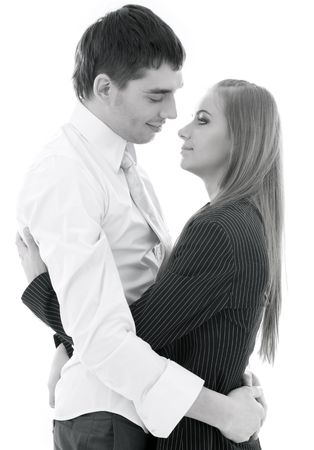 office romance: monochrome picture of happy couple in love over white
