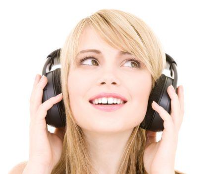 happy teenage girl in headphones over white Stock Photo - 4082225