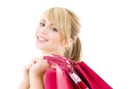 happy teenage girl with pink shopping bags Stock Photo - 4090787
