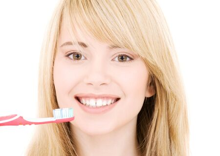 picture of happy girl with toothbrush over white Stock Photo - 4090788