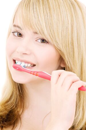 picture of happy girl with toothbrush over white Stock Photo - 4090792