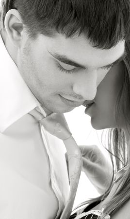 foreplay: monochrome picture of couple in love over white